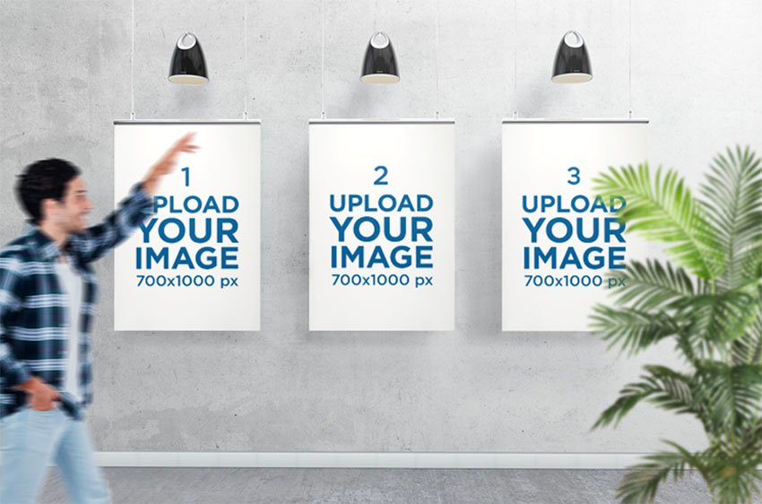 Mockup of Three Posters Displayed Against a Concrete Surface