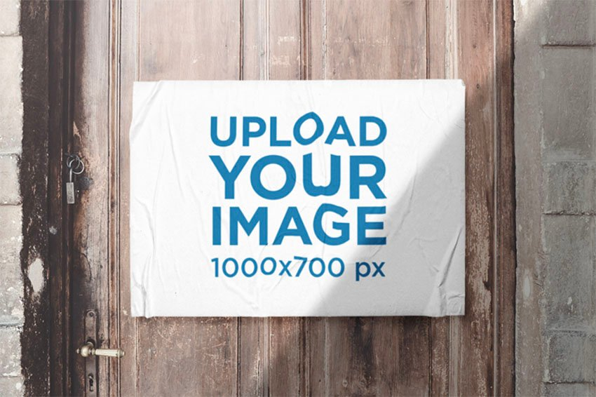 Mockup of an Urban Poster Glued on a Wooden Old Door