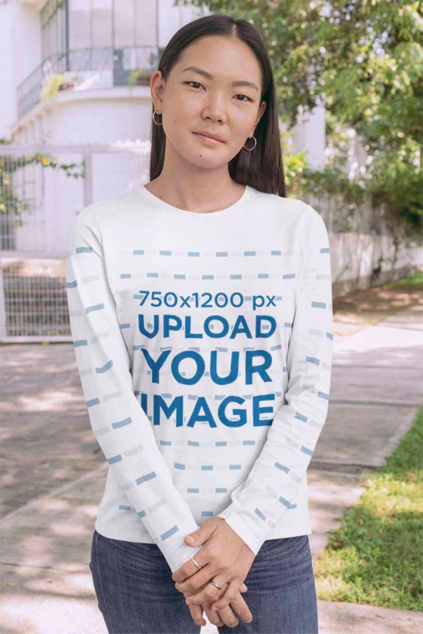 Long Sleeve Tee Mockup Featuring a Young Woman Standing on a Sidewalk