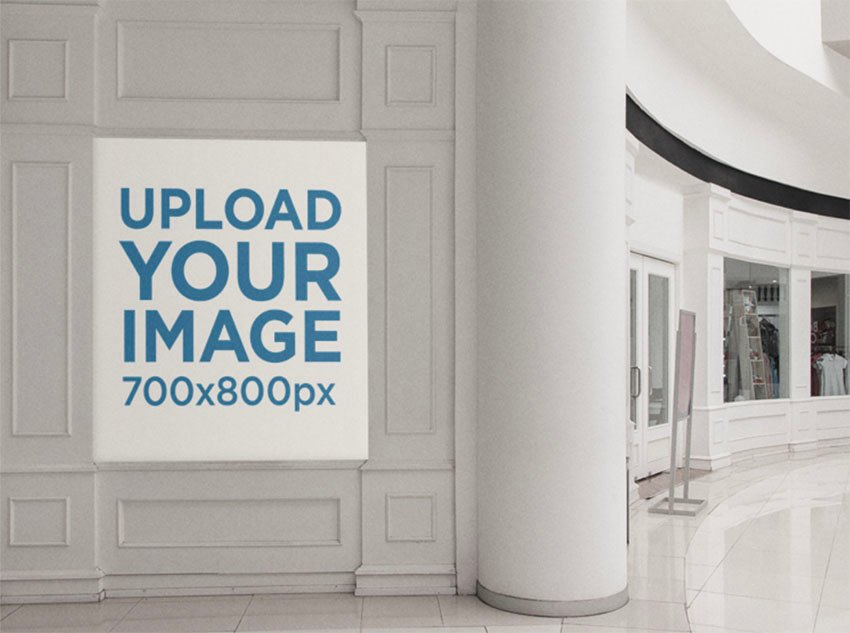 Poster Mockup Placed on a White Wall Inside a Mall
