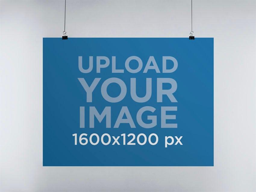 Horizontal Poster Mockup Hanging From a Wall