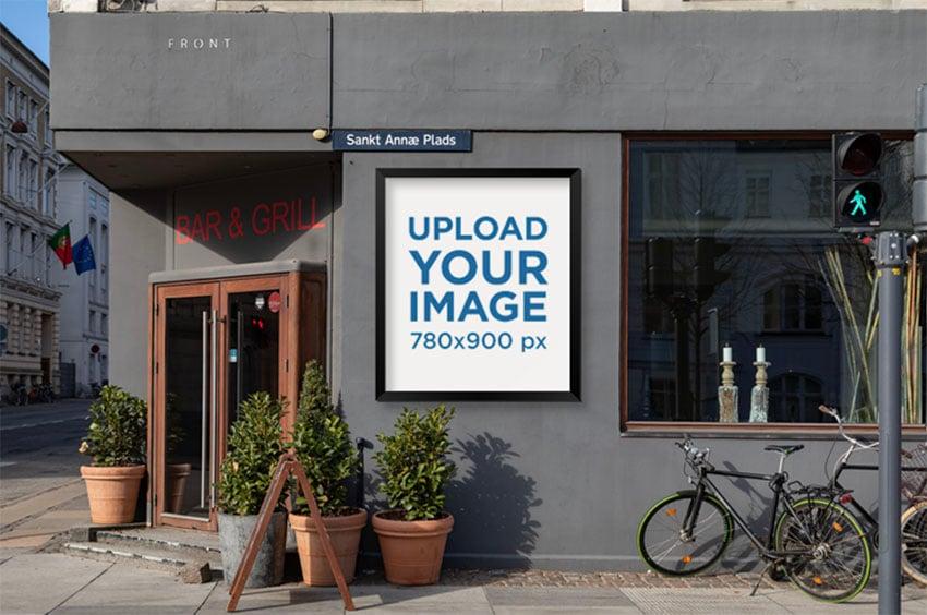 Poster Frame Mockup Placed Next to a Restaurants Entrance