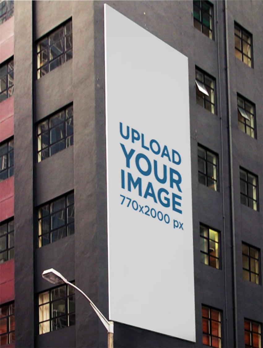 Vertical Wall Billboard Mockup on a Gray Modern Building