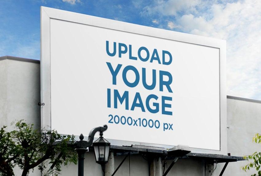 Street Billboard Mockup Against Blue Skies