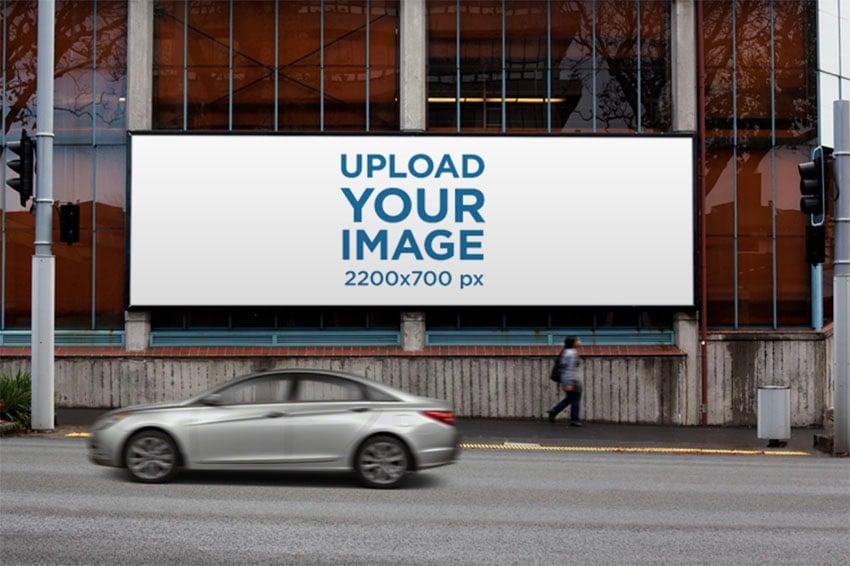 Billboard Street Mockup on a Glass Building