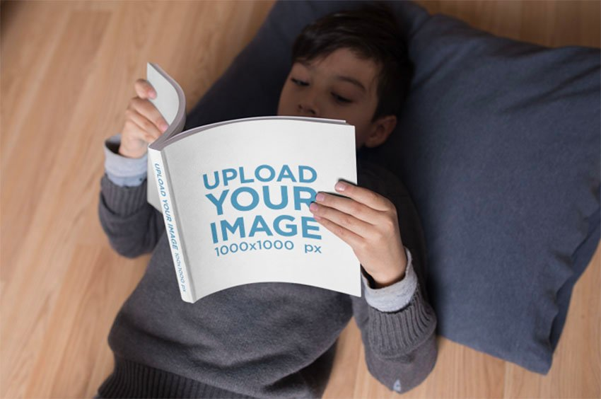 Book Spread Mockup Template with Kid Lying on the Floor