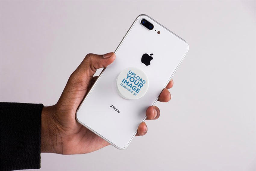 Mockup Featuring a Male Hand Showing an iPhone with a Cell Phone Grip