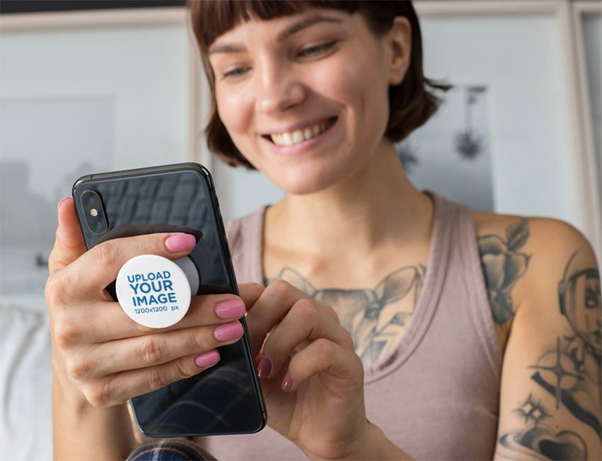 Blank Phone Grip Mockup of a Smiling Short-Haired Woman Looking at Her Phone