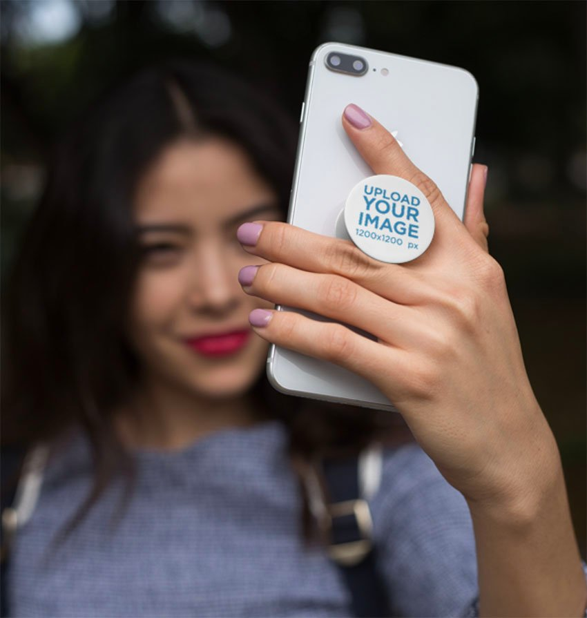 Phone Grip Mockup Featuring a Smiling Woman Taking a Selfie