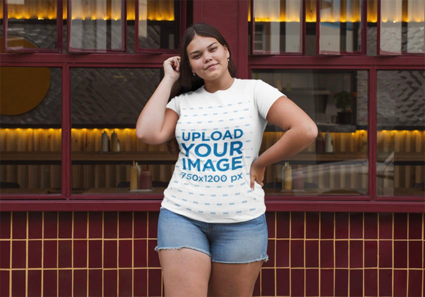 T-Shirt Mockup Size Template of a Woman Posing Outside a Restaurant