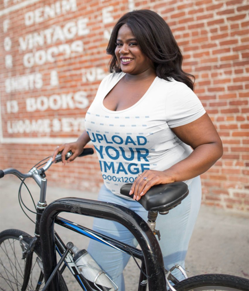 Mockup of a Woman Wearing a Plus Size T-Shirt with her Bike