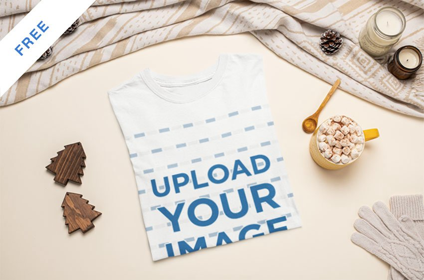 Mockup of a Folded T-Shirt Featuring a Hot Cocoa with Marshmallows