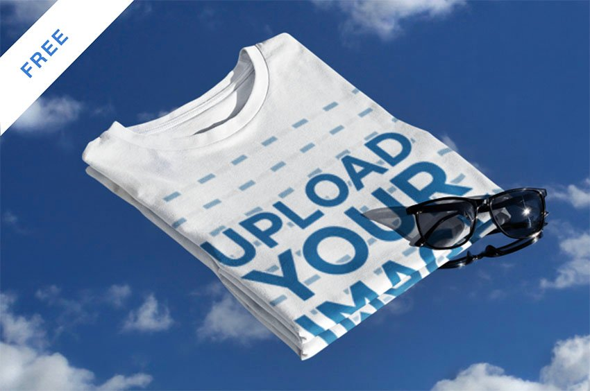 Mockup Featuring a Folded Tee and a Sky Background