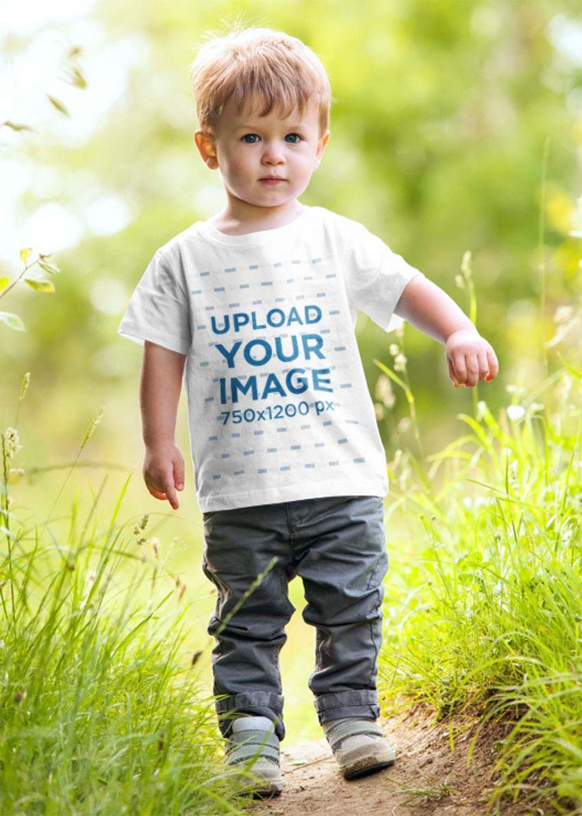 Baby T-Shirt Mockup of a Toddler Playing in the Grass