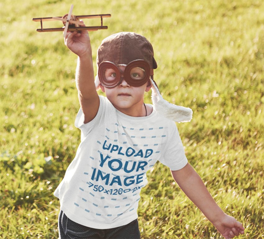 Child Shirt Mockup Featuring a Kid Playing With a Small Plane