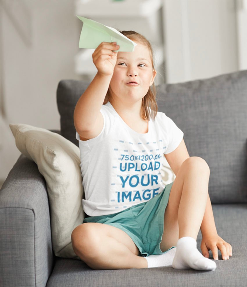 Child T-Shirt Mockup of a Girl Playing with a Paper Plane