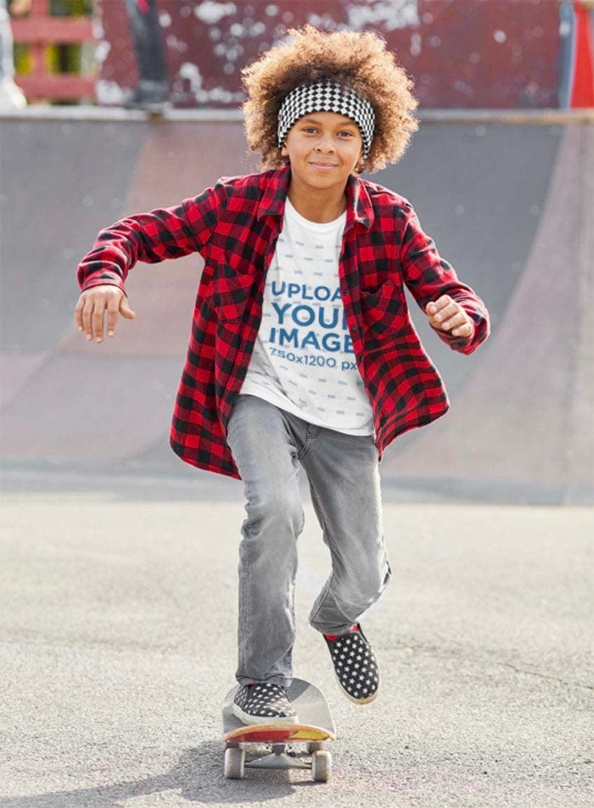Kids White T-Shirt Mockup Featuring a Cool Kid Skateboarding