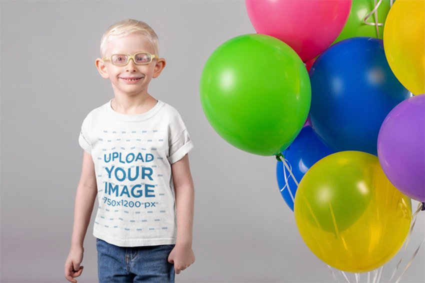 T-Shirt Kid Mockup with Smiling Kid Next to a Set of Balloons
