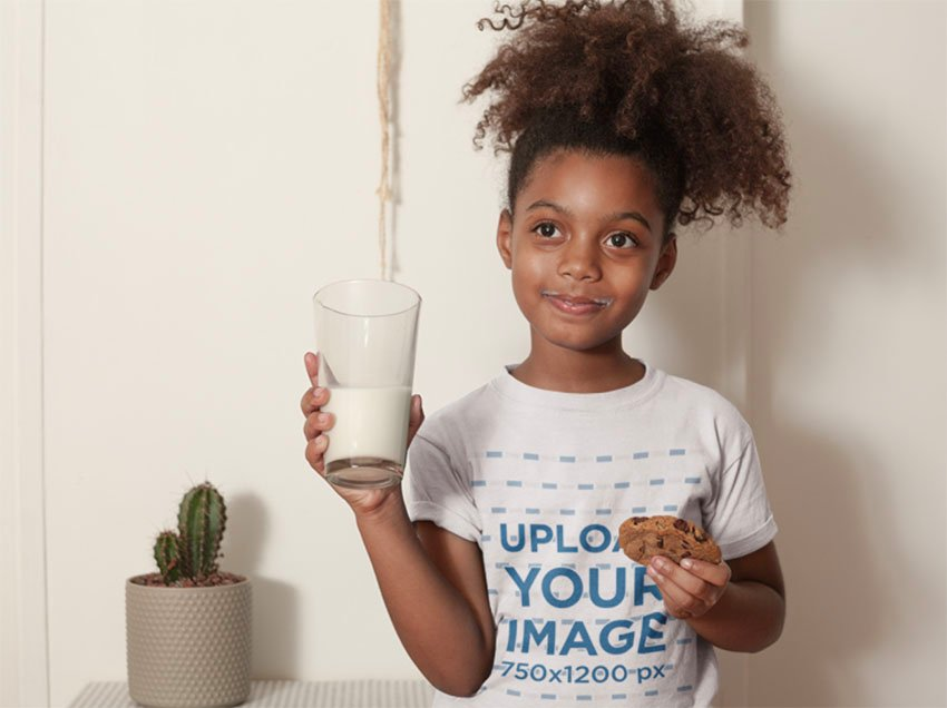 Kids T-Shirt Mockup of a Child Having a Glass of Milk and a Cookie