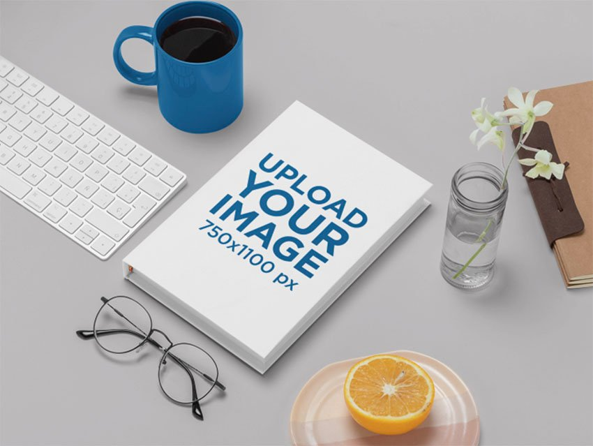 Hardcover Book Mockup Featuring a Stylish Setup