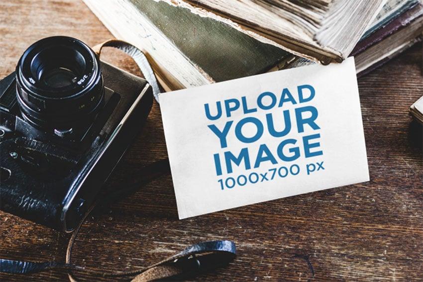 Direct Mail Mockup of a Postcard Beside a Vintage Camera
