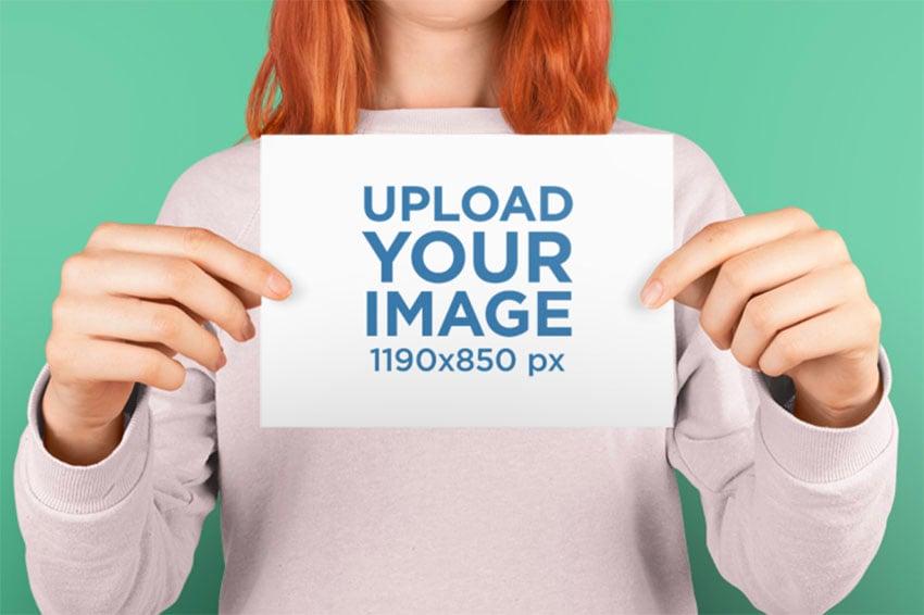 Horizontal Postcard Design Mockup Being Held by Woman