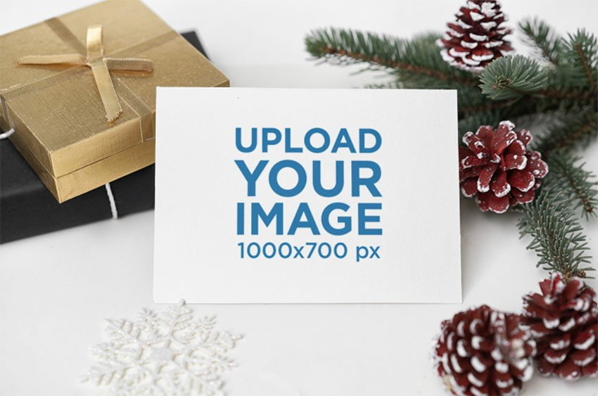 Mail Mockup of a Postcard Surrounded by Christmas Decorations