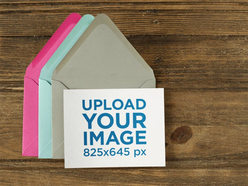 Notecard Mockup Over Three Colorful Envelopes on a Wooden Template