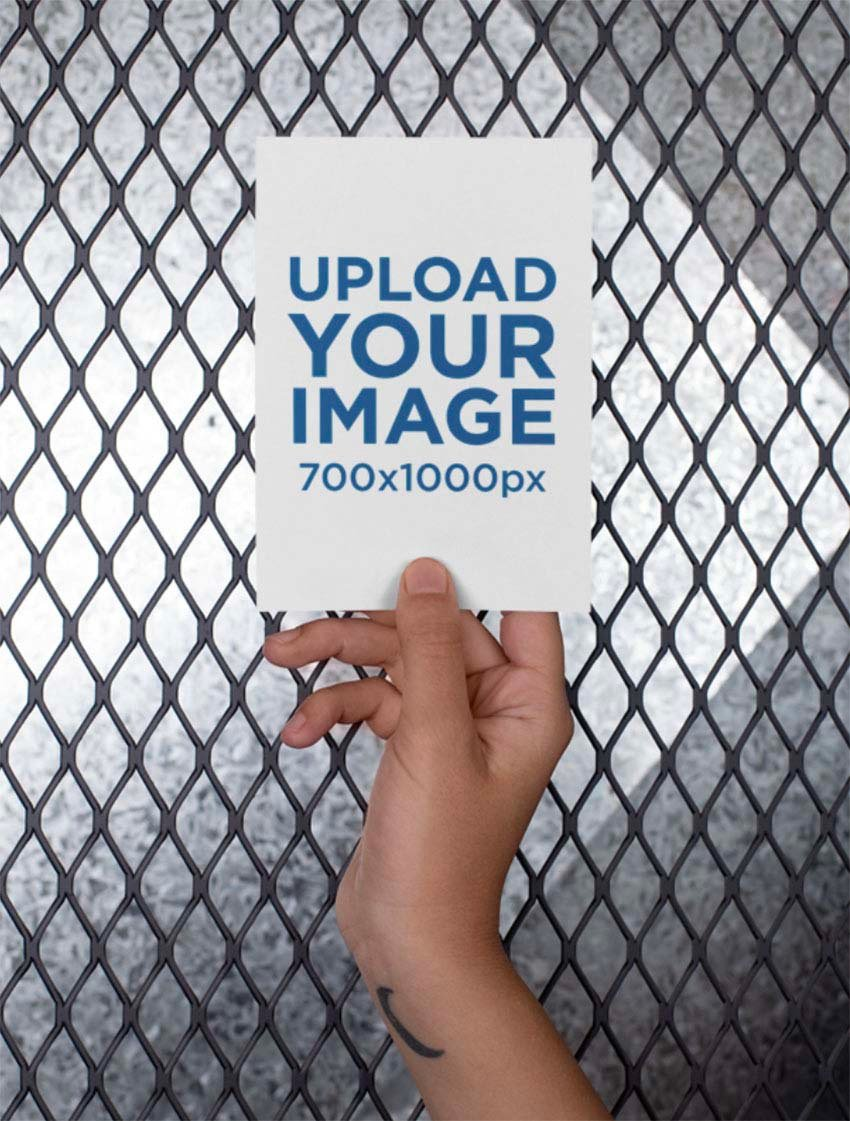 A6 Postcard Mockup Held Up Against a Fence