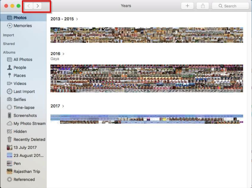 Click the back or forward button to switch views in Photos