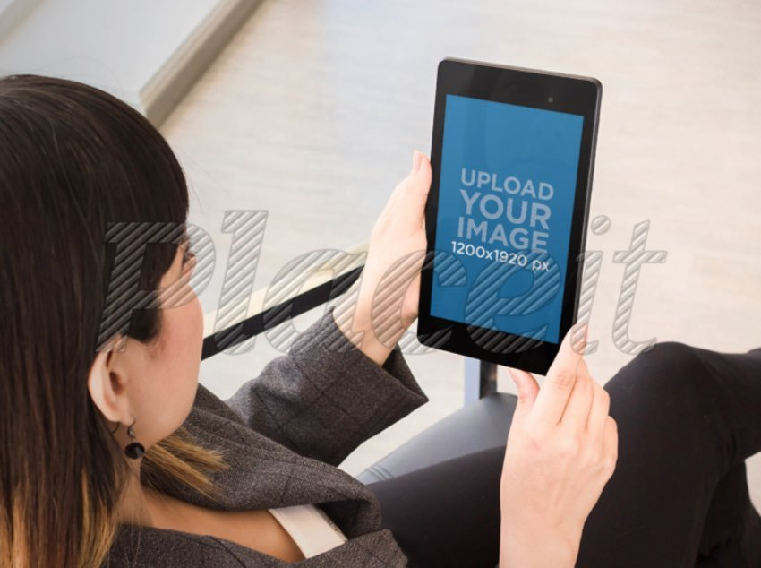 Over Shoulder Mockup Featuring a Woman Using a Nexus 7