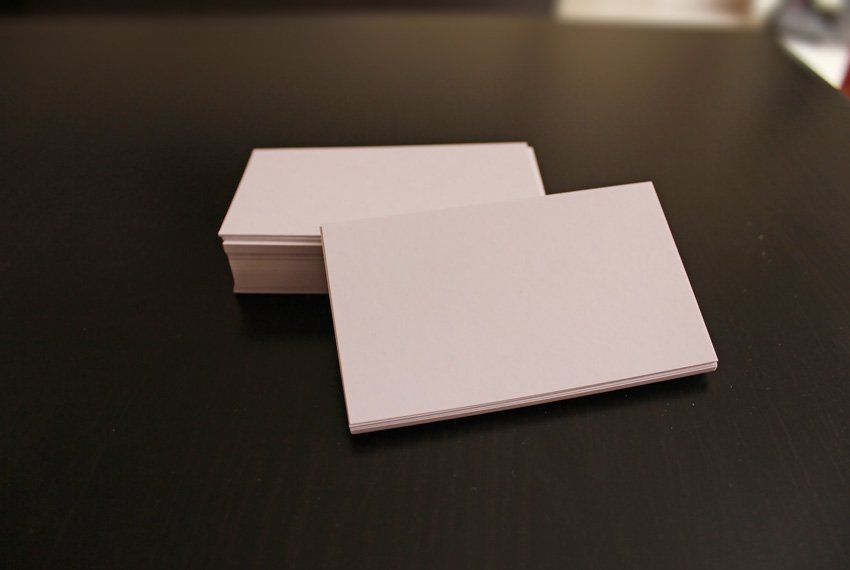 White Business Cards on dark brown table Original Photo