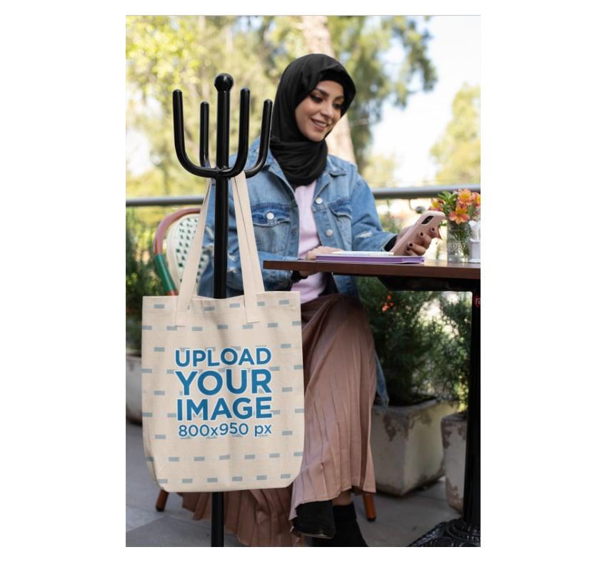 Tote Bag Mockup Woman Wearing Hijab at Restaurant
