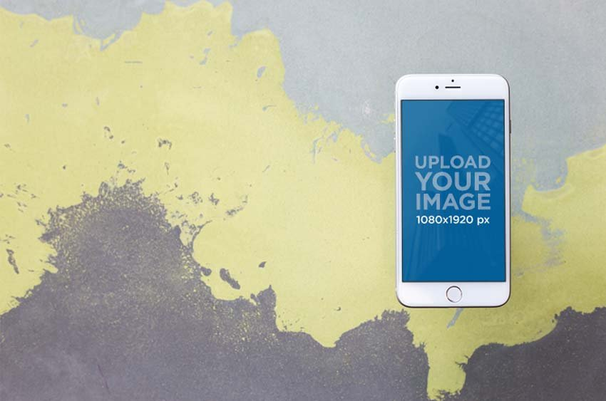 iPhone Mockup Against Painted Wall