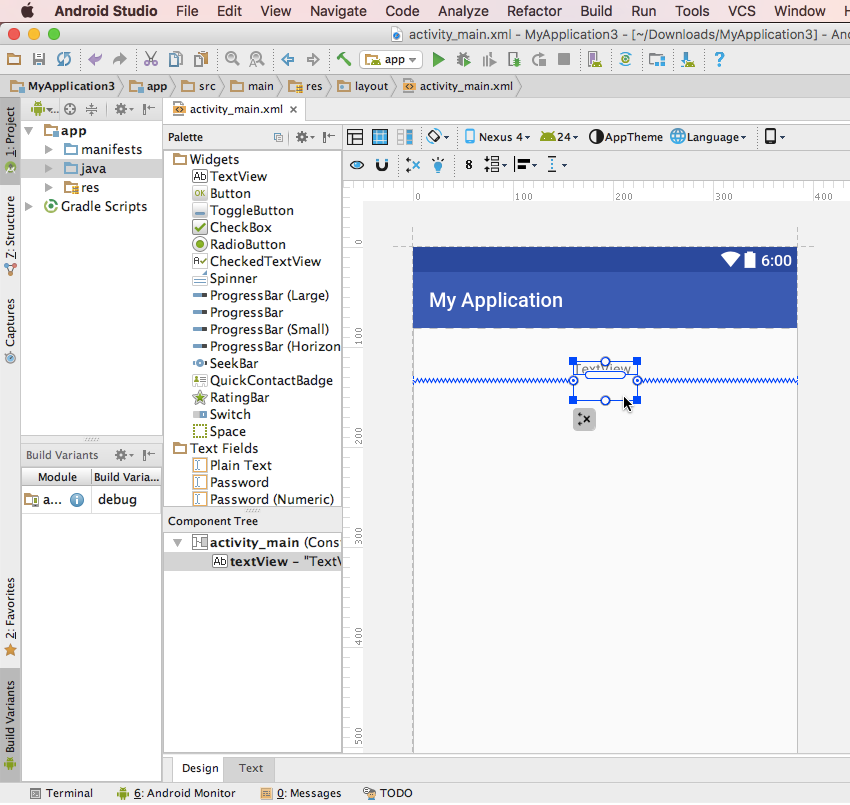 Drag the TextView widget into the correct position and Android Studio will create constraints automatically