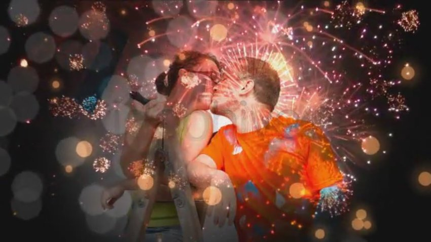 Man and woman kiss double-exposure with fireworks