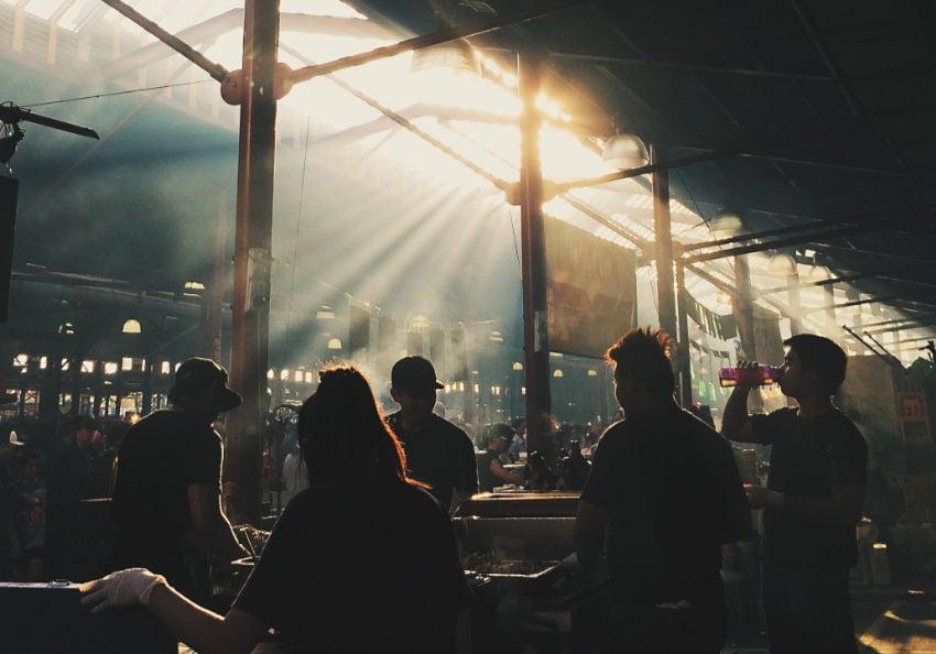 Sunlit people at an indoor market, Melbourne Australia