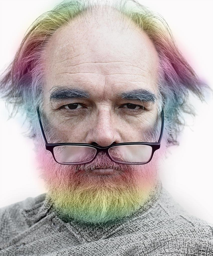 Man with rainbow coloured hair beard and eyebrows