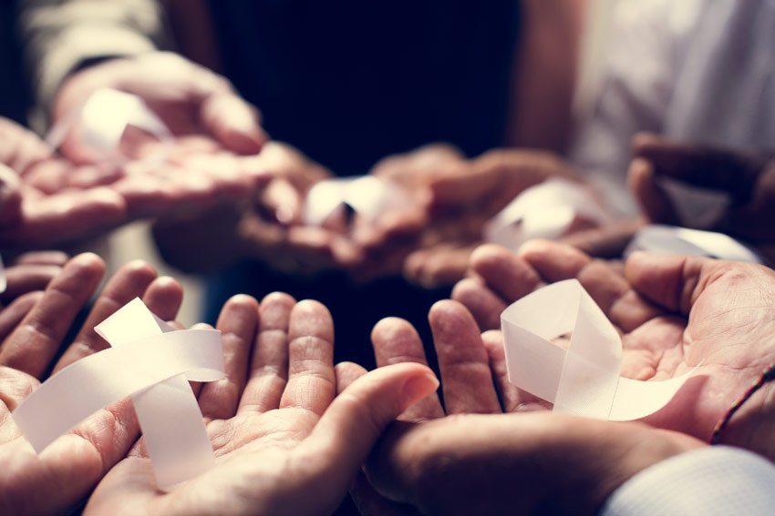 hands holding paper