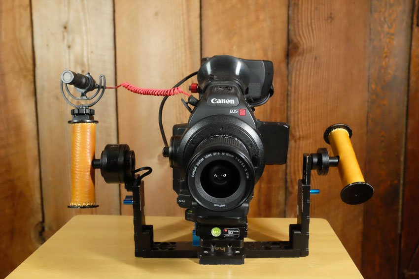 A Canon C100 on a Letus Helix gimbal balanced on a tabletop
