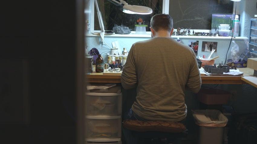 Man sitting at work bench