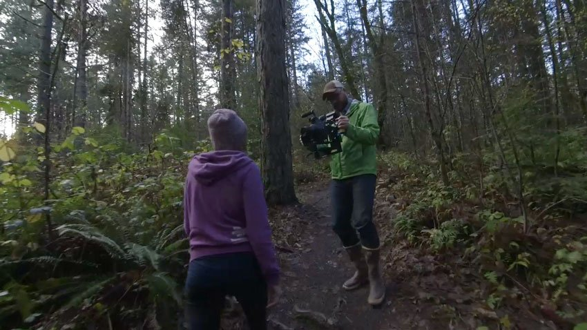 Gimbal camera operator and subject in a forest