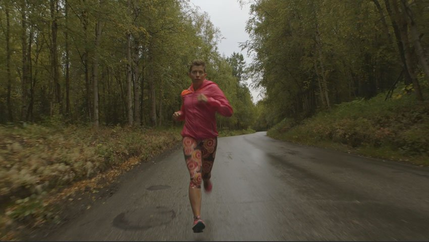 Woman running on a rural road
