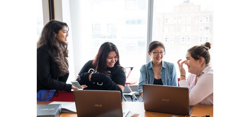 Young women learning how to code with Girls Who Code