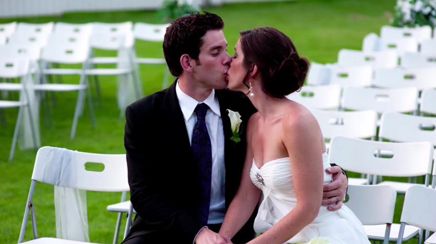 Couple kissing in wedding portrait