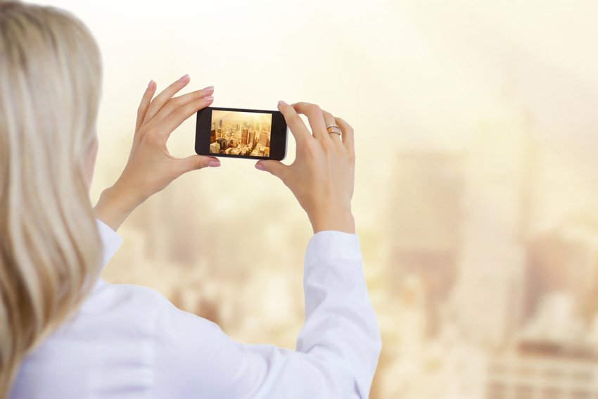 Woman takes video with smartphone
