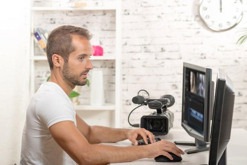 Man editing on desktop computer