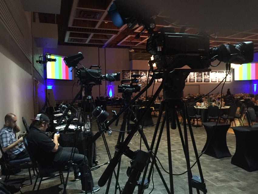 Video cameras at back of room