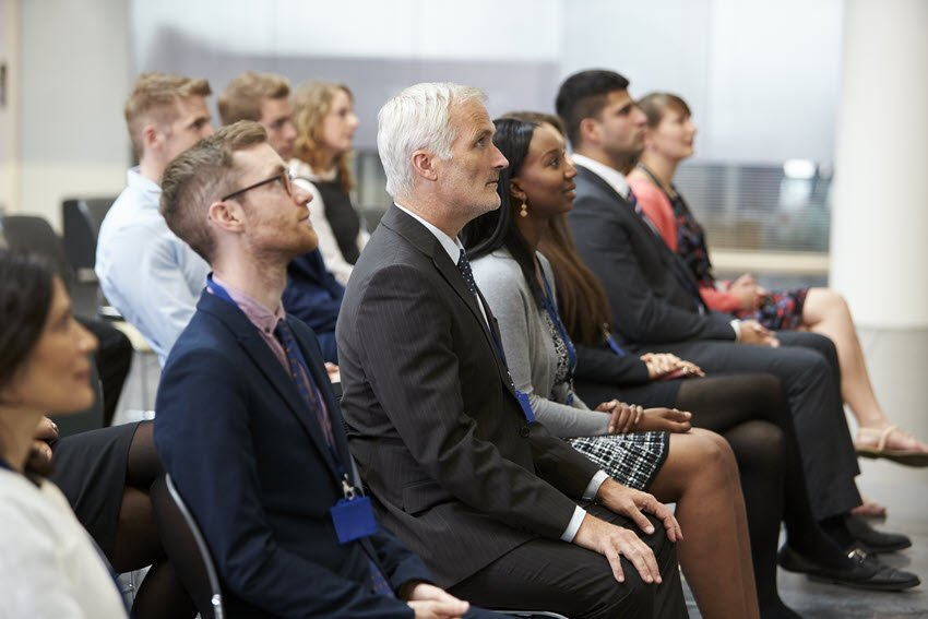 Audience at a persuasive presentation
