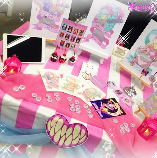 Dashis Koneko-Chan display featuring prints and merchandise